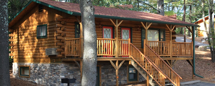 Log Cabins With Covered Decks At Meadowbrook Resort & Dells Packages In Wisconsin Dells